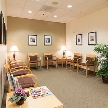 Chairs in the cozy Mt. Scott Endodontics waiting lobby.